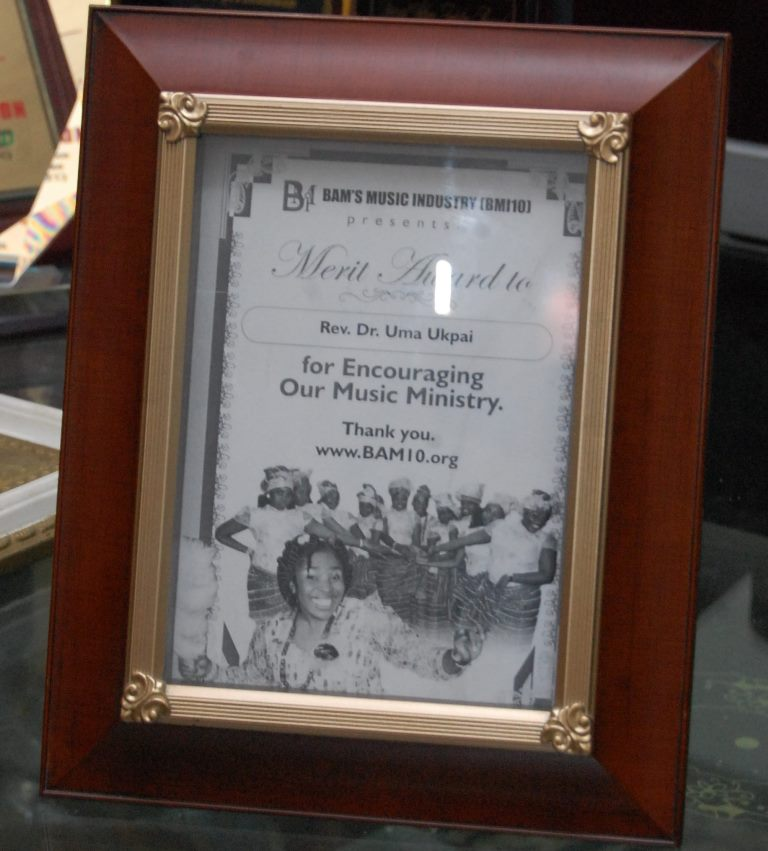 A Merit Award to Rev. Dr. Uma Ukpai by Bam\'s Music Industry(BMI10) for encouraging their Music Ministry
